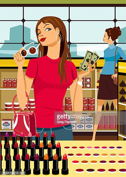 woman holding money at make-up counter in retail store - consumerism stock illustrations
