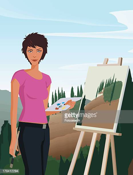 Woman holding paintbrush and palette