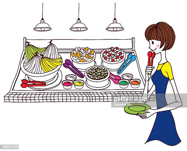Woman holding tongs and looking at foodstuff