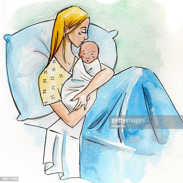 A woman in a hospital bed holding her newborn baby