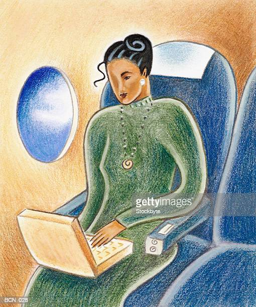 Woman in airplane seat, working on laptop computer
