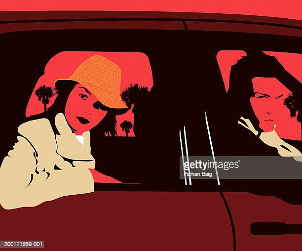 Woman in back of car with man in front, looking through windows