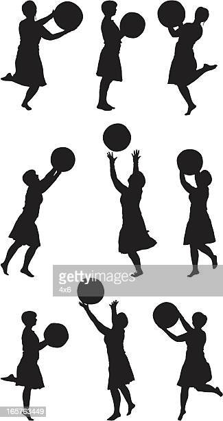 woman in dress with beach ball silhouette - standing on one leg stock illustrations, clip art, cartoons, & icons