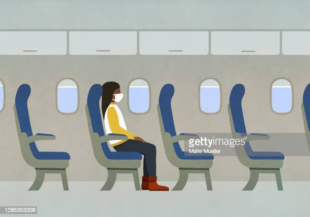 woman in face mask riding airplane alone - journey stock illustrations