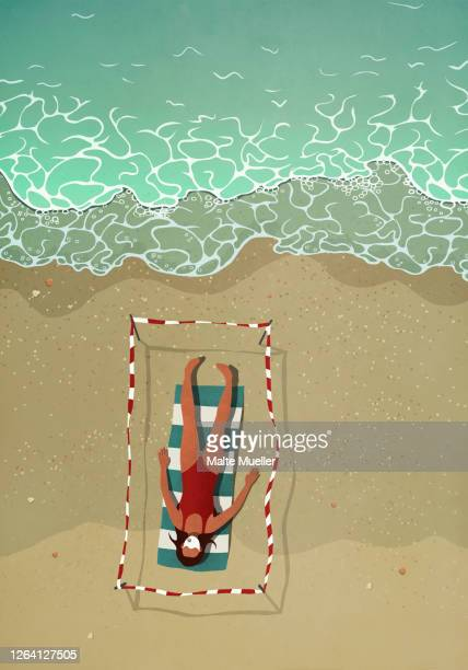 woman in face mask sunbathing in taped off section on summer beach - safety stock illustrations