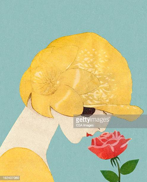 Woman in Hat Smelling Rose