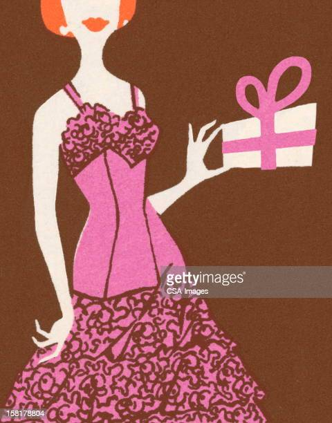 Woman in Pink Dress Holding Gift