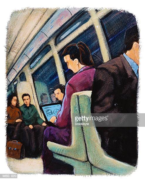 Woman in subway train using laptop computer