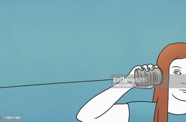 woman listening in tin can telephone - communication problems stock illustrations, clip art, cartoons, & icons