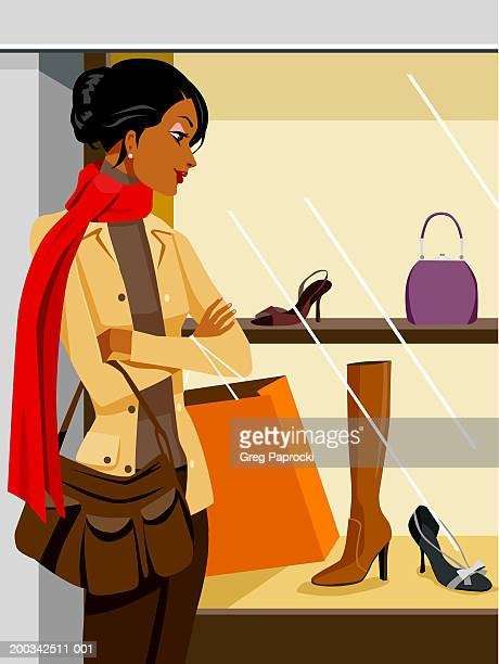 woman looking at shoes and purses in retail window display, side view - consumerism stock illustrations