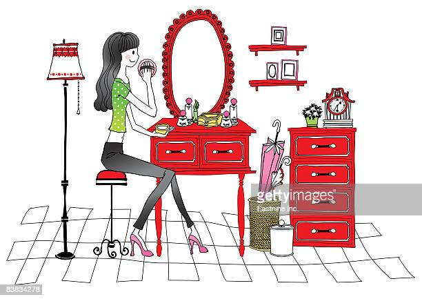Woman looking into mirror, applying compact