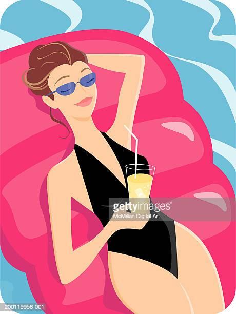 illustrations, cliparts, dessins animés et icônes de woman lying on raft in pool, holding drink - matelas pneumatique