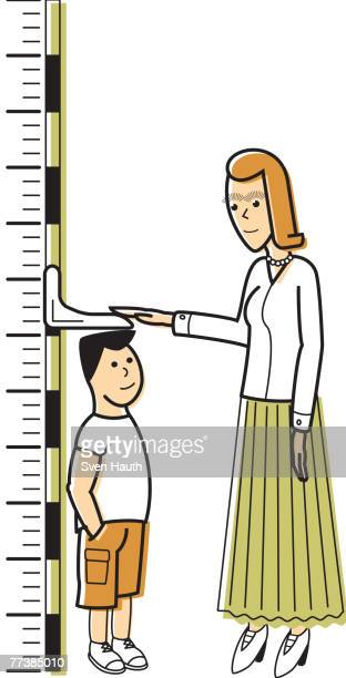 a woman measuring a boy against a growth chart - child growth chart stock illustrations, clip art, cartoons, & icons