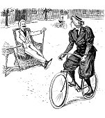 woman bicycle looks towards sitting man