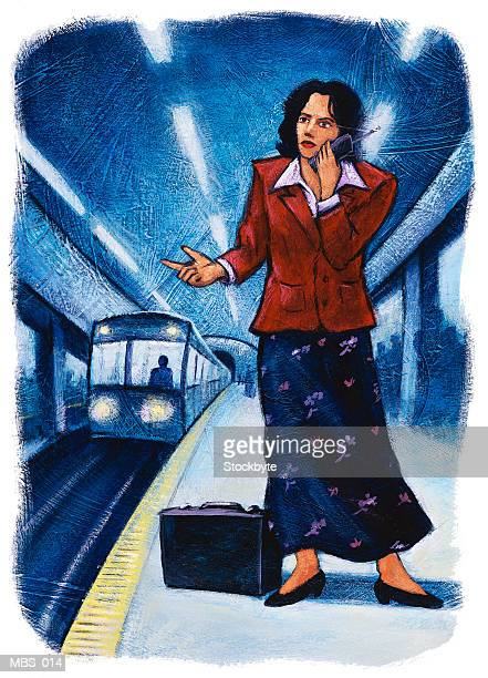 Woman on subway platform using cellular phone