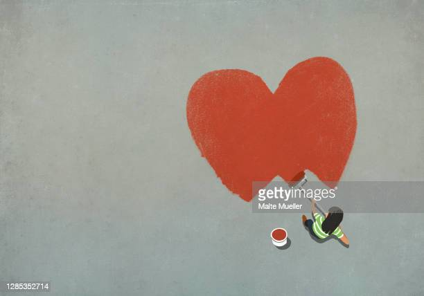 woman painting red heart with paint roller - one young woman only stock illustrations