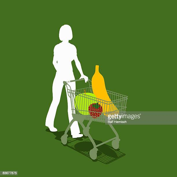 a woman pushing a shopping trolley with fruit - one mid adult woman only stock illustrations