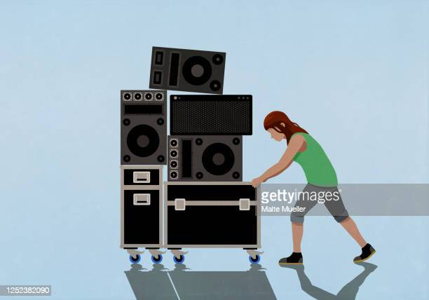 woman pushing speakers and music equipment on cart - {{relatedsearchurl(carousel.phrase)}} stock illustrations