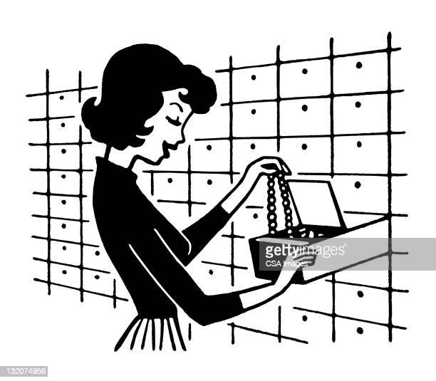 Woman Putting Necklace in Safety Deposit Box