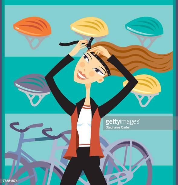 a woman putting on a bike helmet - bike helmet stock illustrations, clip art, cartoons, & icons