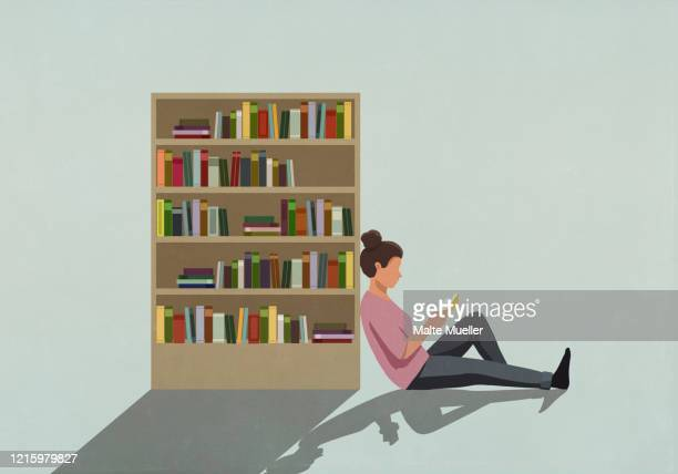 woman reading book against bookcase - reading stock illustrations