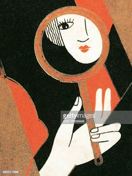 Woman reflected in hand mirror