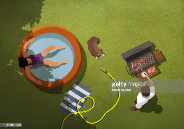 woman relaxing in kiddie pool while man barbecues in backyard - mid adult stock illustrations