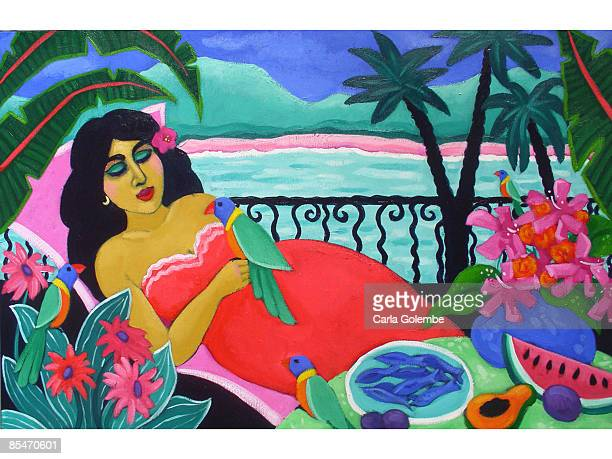 A woman relaxing with parrots next to the sea
