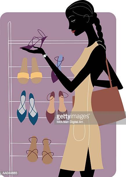 Woman shopping for shoes, profile