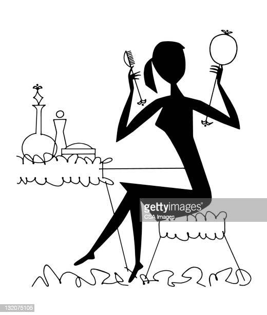 Woman Sitting at Vanity