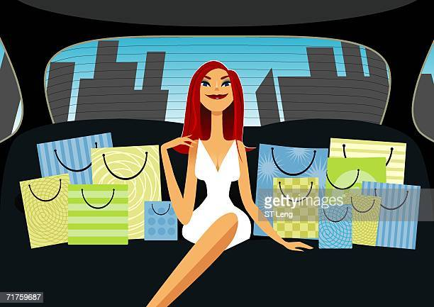 Woman sitting in a car with shopping bags