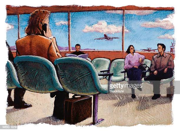 Woman sitting in airport lounge, using cellular phone