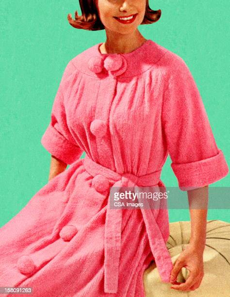 Woman Sitting in Pink Robe