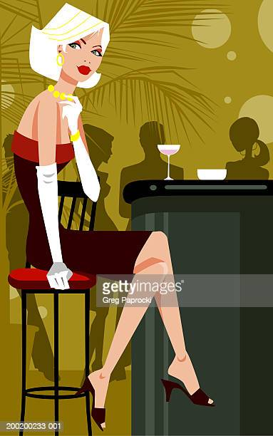 Woman sitting on stool at bar counter, legs crossed at knee
