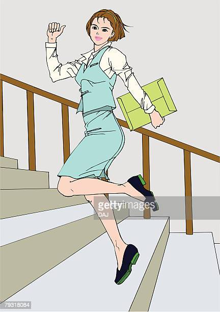 Woman skipping on stairs, portrait, side view