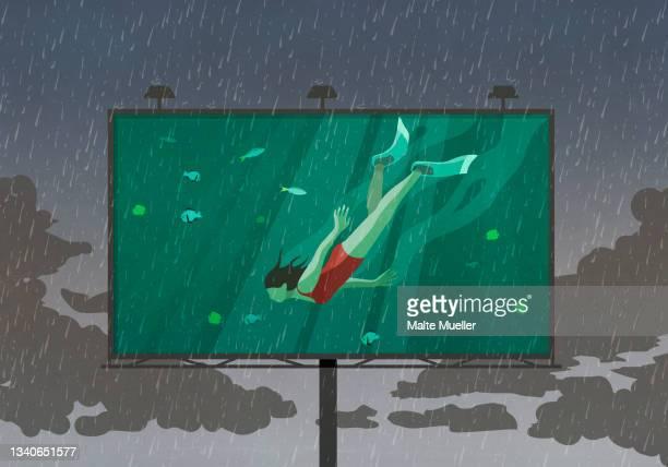woman snorkeling underwater on billboard against rainy sky - exploration stock illustrations