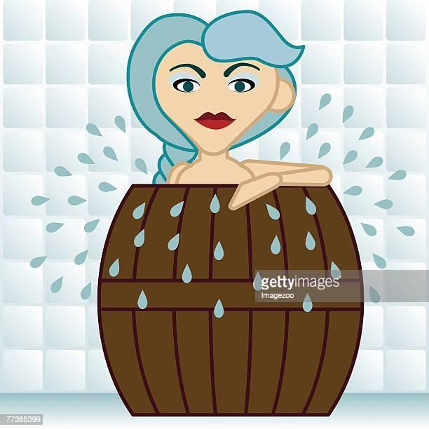Woman soaking in a barrel tub