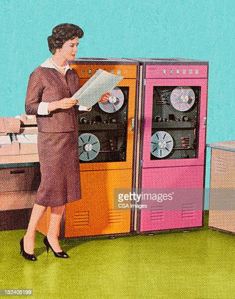 Woman Standing at Old Computers