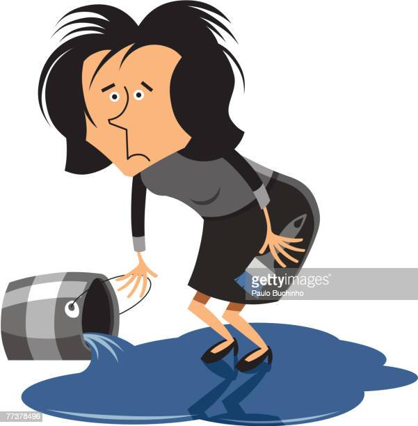 A woman standing on a pool of spilled paint