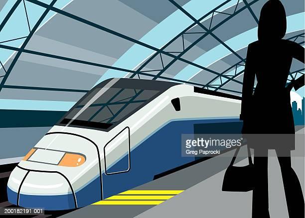 woman standing on train platform, silhouette - three quarter length stock illustrations