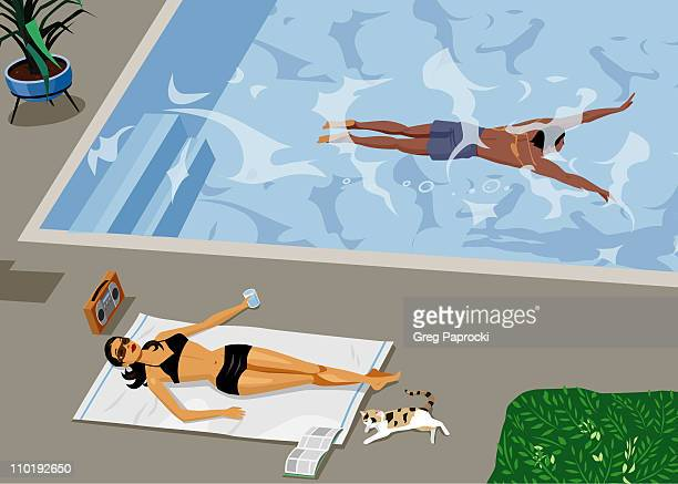 Woman sunbathing beside swimming pool