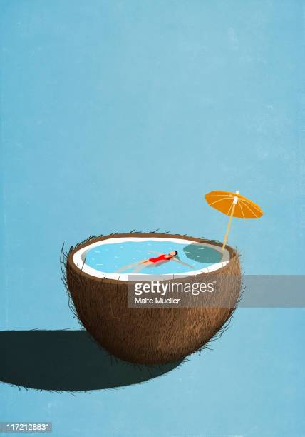 woman swimming in tropical coconut pool - food and drink stock illustrations