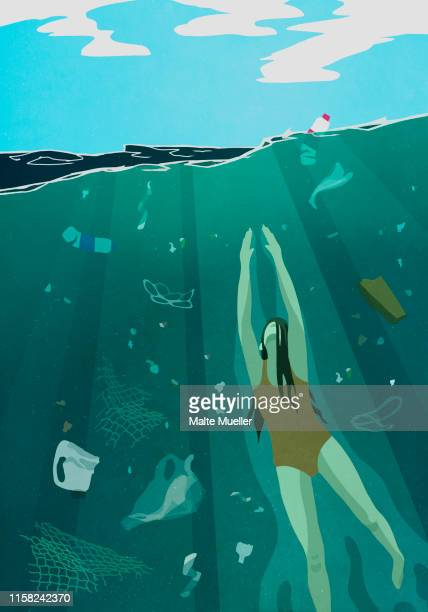 woman swimming underwater in ocean surrounded by pollution - water pollution stock illustrations