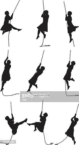 Woman swinging from a rope