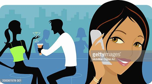 Woman talking on cell phone, couple have cocktails in bar