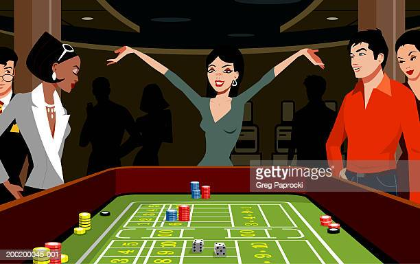 Woman throwing dice at craps table, arms raised