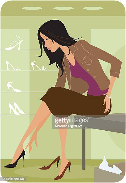 Woman trying on shoes in retail store, side view