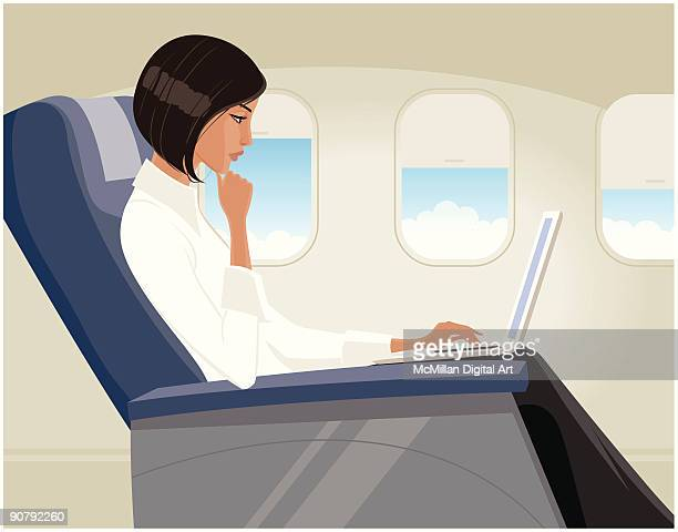 Woman using laptop on airplane