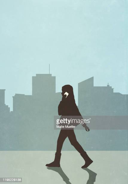 woman walking and talking on smart phone in city - {{relatedsearchurl(carousel.phrase)}} stock illustrations