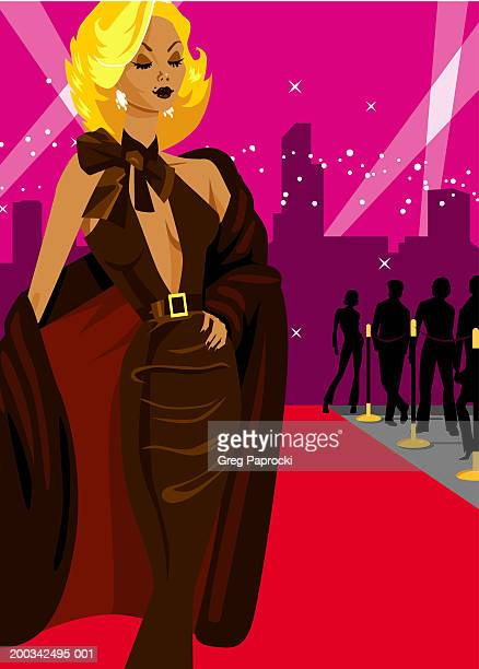 Woman walking down red carpet, hand on hip